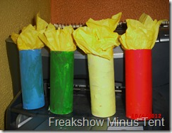 toilet paper tubes painted to look like candles with tissue paper flames