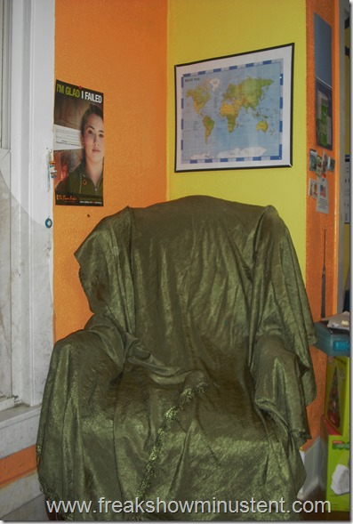 green reading chair in homeschool room