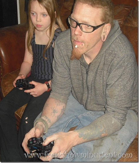 daddy and daughter playing Call of Duty