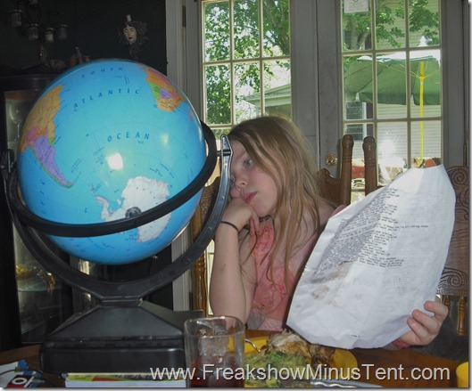 Spider monkey searching for countries on her intelliglobe