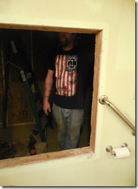 Mr. wearing his Rammstein shirt while renovating a bathroom